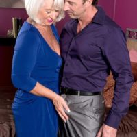 Clothed 60 plus MILF Jeannie Lou baring big mature tits in crotchless panties