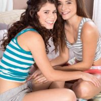 Clothed teen girls Lexy Lotus and Kharlie Stone tongue kissing in socks