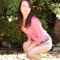Clothed teen Jennifer Matthews flashing upskirt panties outdoors
