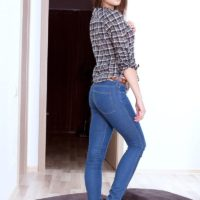 Dark haired babe Barbi posing non nude in jeans before baring thong clad ass