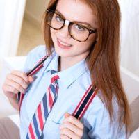 Glasses wearing schoolgirl Alice Green baring tiny teen tits in panties