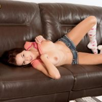 Knee sock adorned teen pornstar Madi Meadows baring big natural breasts