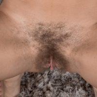 Leggy brunette amateur Chloe R slipping off panties to expose hairy vagina