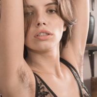 Lingerie attired amateur Christy freeing small tits and hairy pussy from lingerie