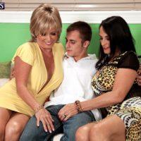 Mature lesbians Lexi McCain and Rita Daniels having threesome sex in high heels