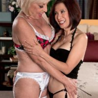 Mature lesbians Scarlet Andrews and Kim Anh having interracial threesome sex