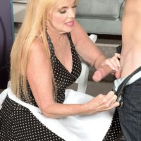 Non nude blonde over 60 MILF Charlie delivering CFNM handjob to big cock