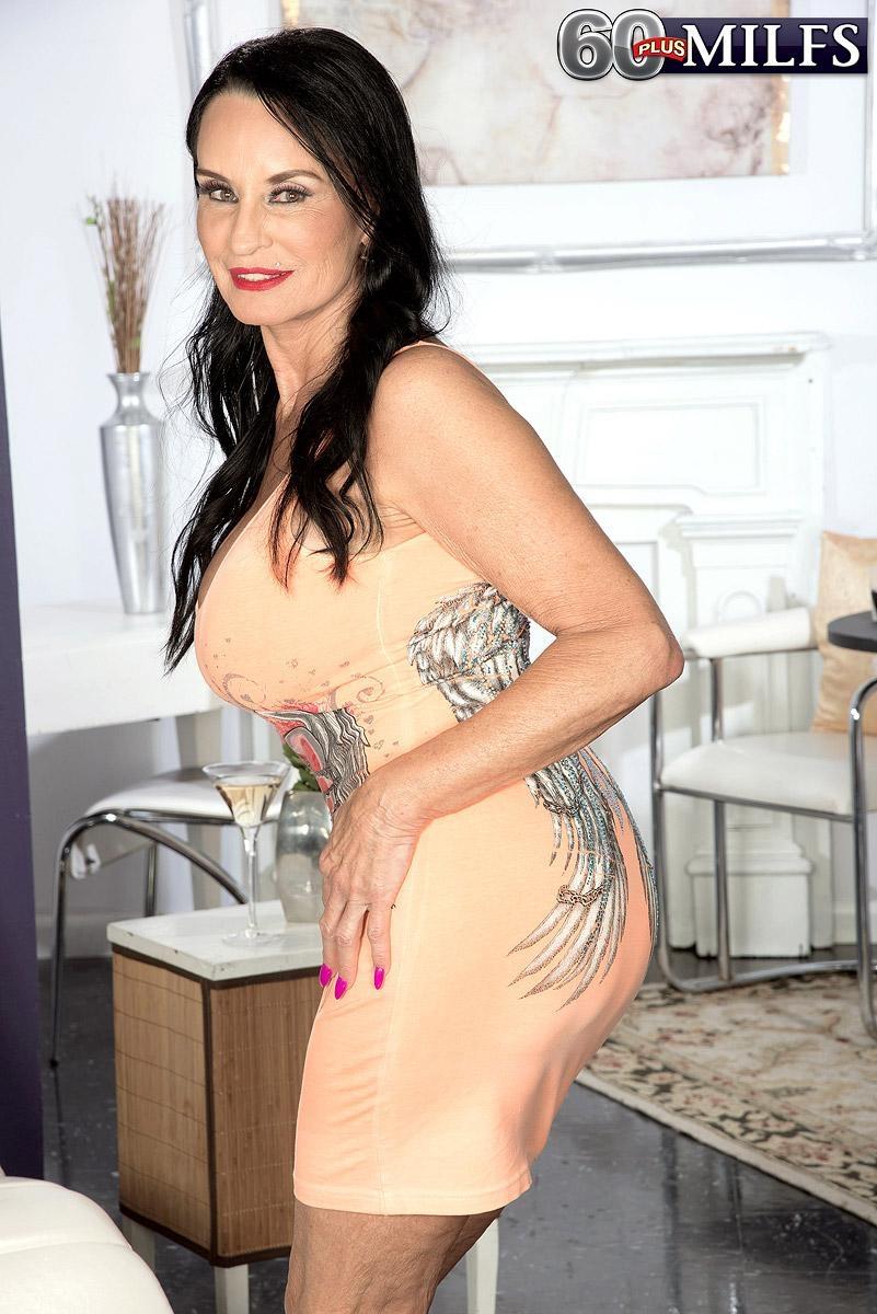 Over 60 brunette MILF Rita Daniels showing off great legs and huge knockers