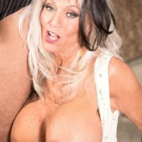 Over 60 MILF Sally D'Angelo loosing large tits before giving big cock oral sex