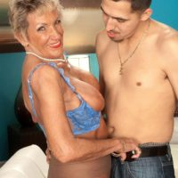 Pantyhose adorned 70 plus MILF Sandra Ann baring big tits before sex with younger man