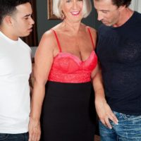 Pantyhose clad mature lady Jeannie Lou showing off big ass before MMF threesome