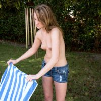 Petite teen Lizzy Bell freeing tiny tits from bikini top outdoors in denim shorts