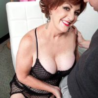 Redhead granny Gabriella LaMay freeing large tits and nipples from bodystocking