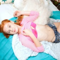 Redhead teen amateur Alex Tanner revealing small tits in denim shorts before toying