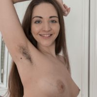 Stocking clad amateur Cherry Bloom displaying furry armpits and hairy vagina