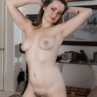 Tattooed amateur Kelly Morgan baring small tits and hairy cunt while undressing