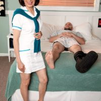 Uniformed 60 plus Asian MILF nurse Kim Anh giving large cock handjob in hospital
