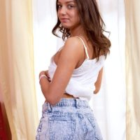 18 year old brunette babe Foxy Di exposing small teen tits in underwear and barefeet