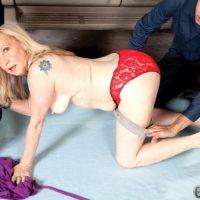 60 plus blonde granny Miranda Torri exposing big mature tits before MMF 3some