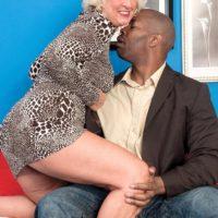 Blonde grandma Jeannie Lou giving big black cock interracial blowjob in lingerie