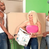 Blonde granny Julia Butt exposing nice melons in jeans before interracial MMF 3some