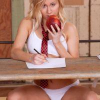 Blonde schoolgirl Vanessa Staylon flashing upskirt panties before baring bald cunt