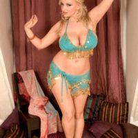 Blonde solo girl Sophie Mae letting massive juggs free from bikini top