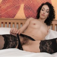 Brunette amateur Cleo Dream freeing sexy legs from nylons before spreading beaver