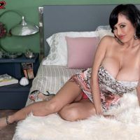 Brunette Euro pornstar Claudia KeAloha baring massive tits and giving MMF handjobs