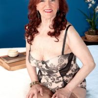 Busty redhead granny Katherine Merlot giving large cock oral sex in stockings