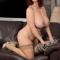 Chubby babe Vanessa Y flashing massive all natural hanging tits in stockings