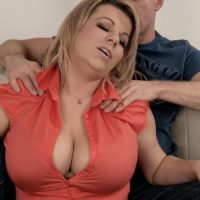 Chubby blonde babe Veronika freeing huge boobs from bra before giving titty fuck