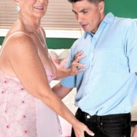 Chubby granny Joanne Price baring big tits before giving big cock oral sex in pantyhose