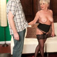 Chubby mature amateur DeAnna Bentley exposing big tits in nylons before BJ