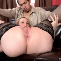 Chubby pornstar Brandi Sparks sliding panties over big ass in stockings and heels