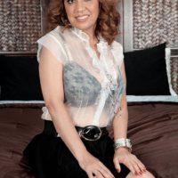 Latina solo girl Marisa Carlo exposing nice melons and upskirt panties in high heels