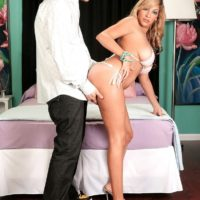 Leggy blonde babe Kitana Flores loosing large juggs from bikini in high heels