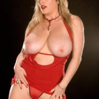 Leggy blonde babe Maggie Green freeing massive natural tits from dress