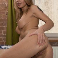 Leggy blonde European babe Darina Nikitina spreading hairy pussy in socks