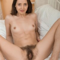 Leggy brunette amateur Lisa Carry slipping panties over ass to reveal hairy twat