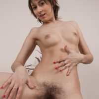 Leggy brunette amateur with small boobs spreading hairy pussy after undressing