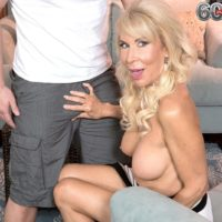 Leggy over 60 blonde MILF Erica Lauren revealing big mature tits and shaved pussy