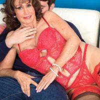Lingerie attired brunette grandma Jacqueline Jolie exposing huge tits for nipple licking
