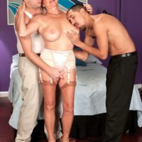 Lingerie attired over 60 MILF Bea Cummins jerking off big cocks in MMF threesome