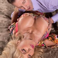 Mature blonde babe Cara Reid freeing nice melons for licking of pornstar nipples