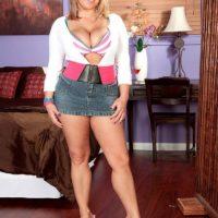 Non nude blonde babe Anastasia Blake showing off cleavage in denim skirt