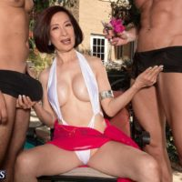 Over 60 Asian MILF Kim Anh jerking off big cocks outdoors before MMF sex