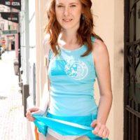 Redhead amateur Linda Sweet flashing upskirt panties outdoors before baring small tits