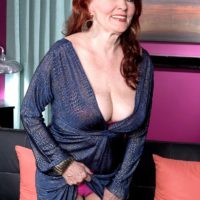 Redhead granny Katherine Merlot exposing large natural tits to seduce sex