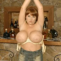 Redhead solo girl Brandy Dean unveiling massive boobs in denim skirt and heels